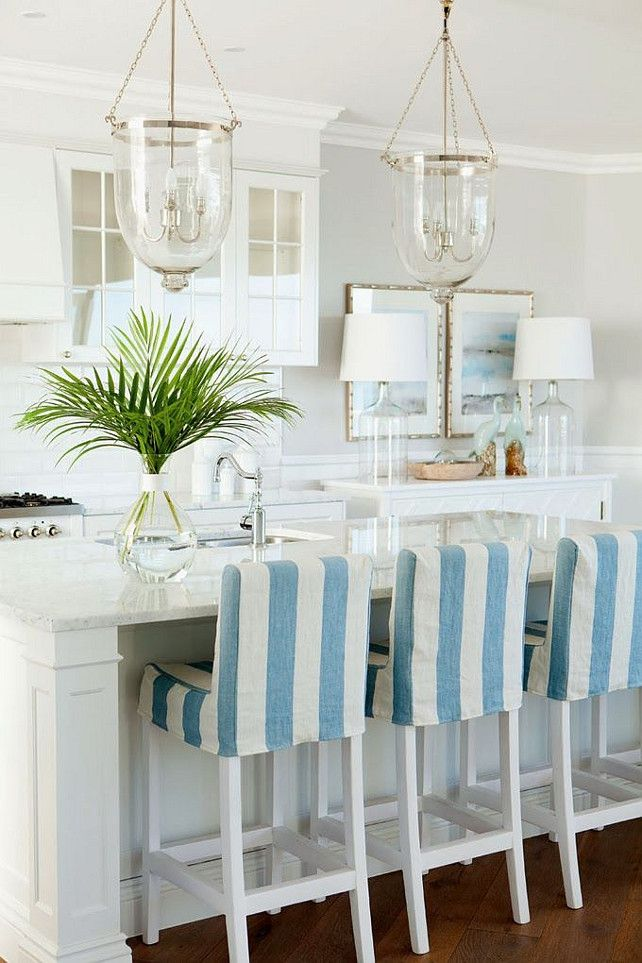 Coastal kitchen with bell jar lantern pendants