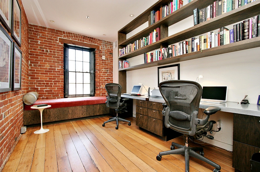 Exposed brick walls and industrial windows in the home office
