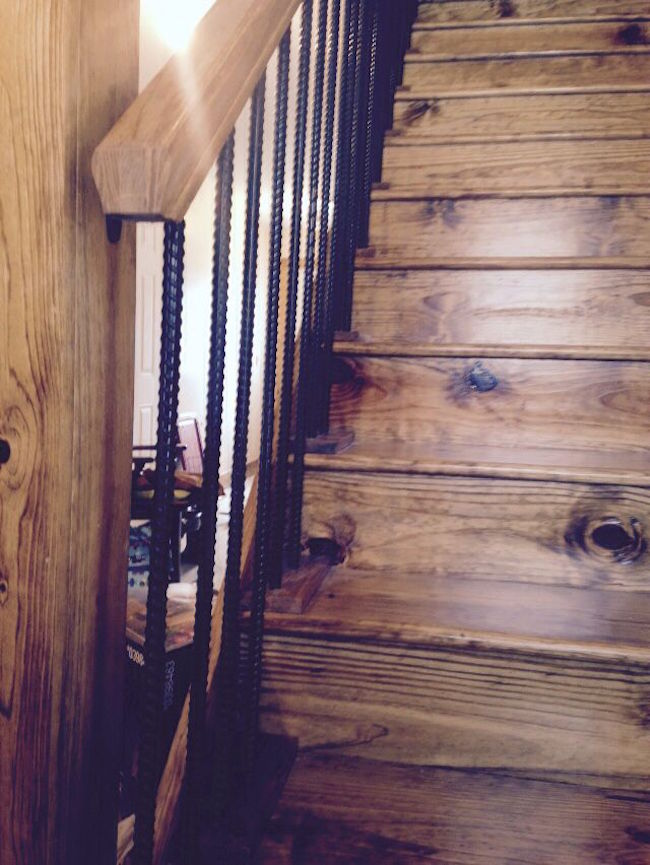 Rebar painted black for railing on rustic stair case
