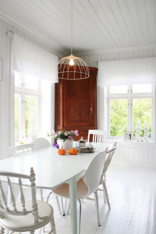 white tufted dining chairs with white scandinavian
