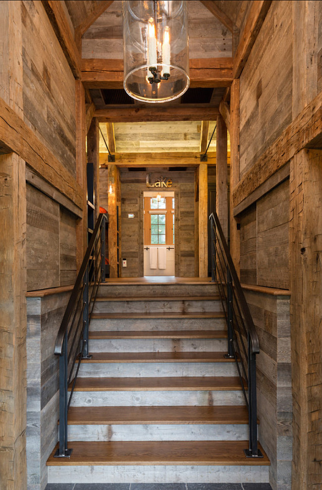 Rustic entryway with reclaimed wood floors