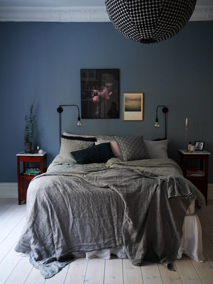 Blue walls grey bedspread bedroom