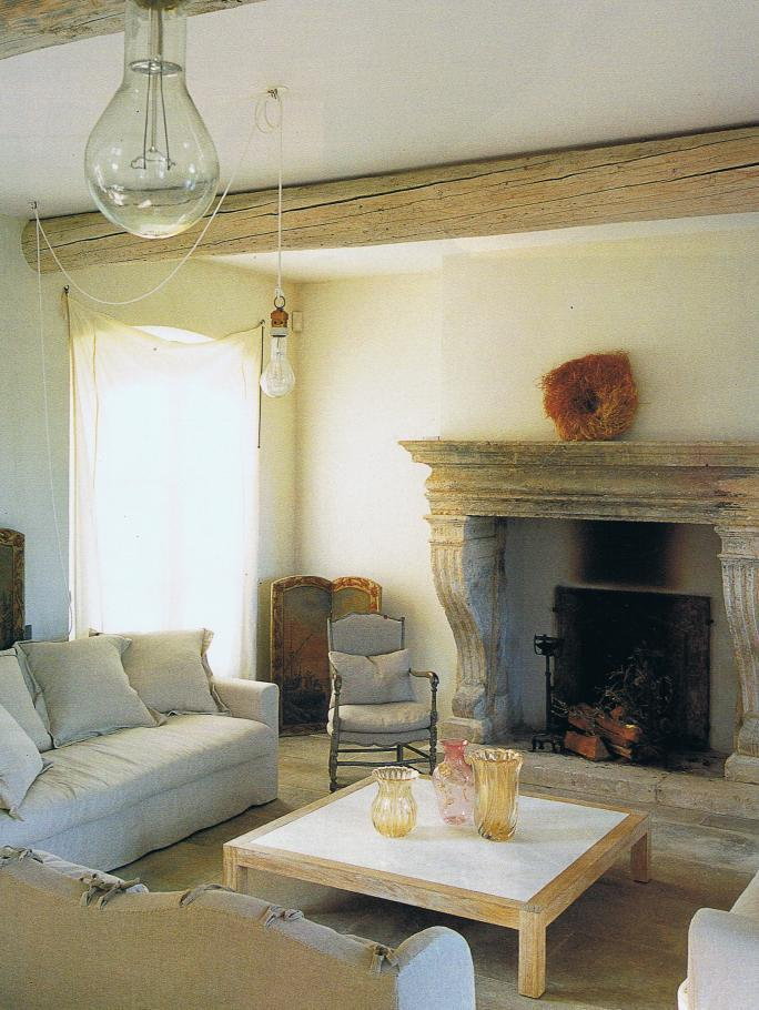 Provence living room with limewashed walls and stone fireplace