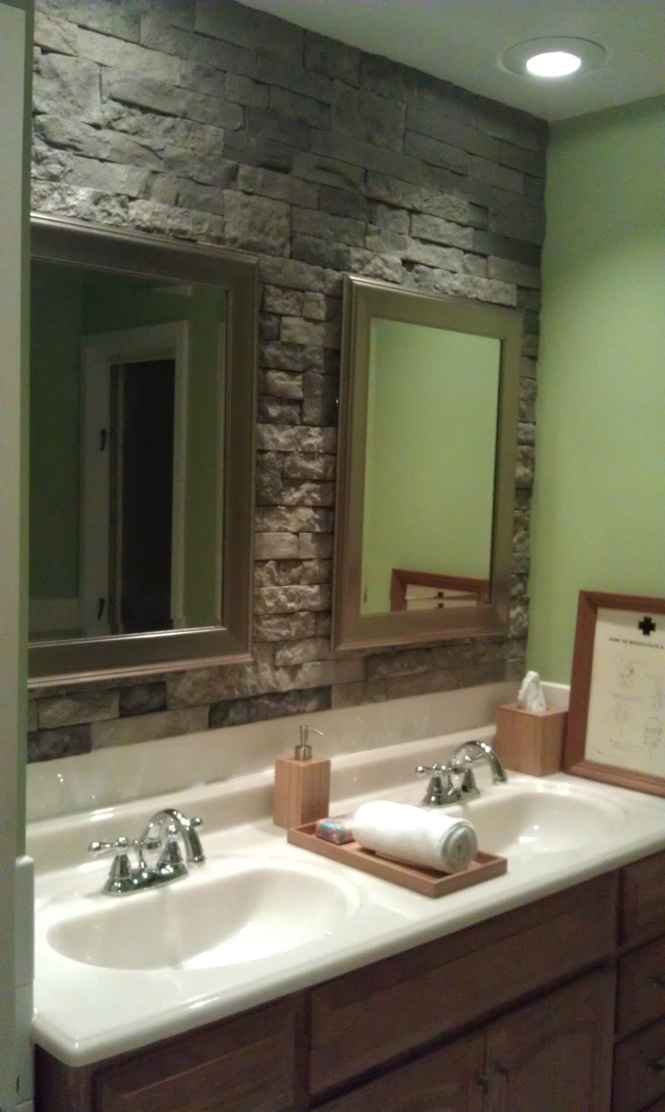 airstone stone accent wall in bathroom
