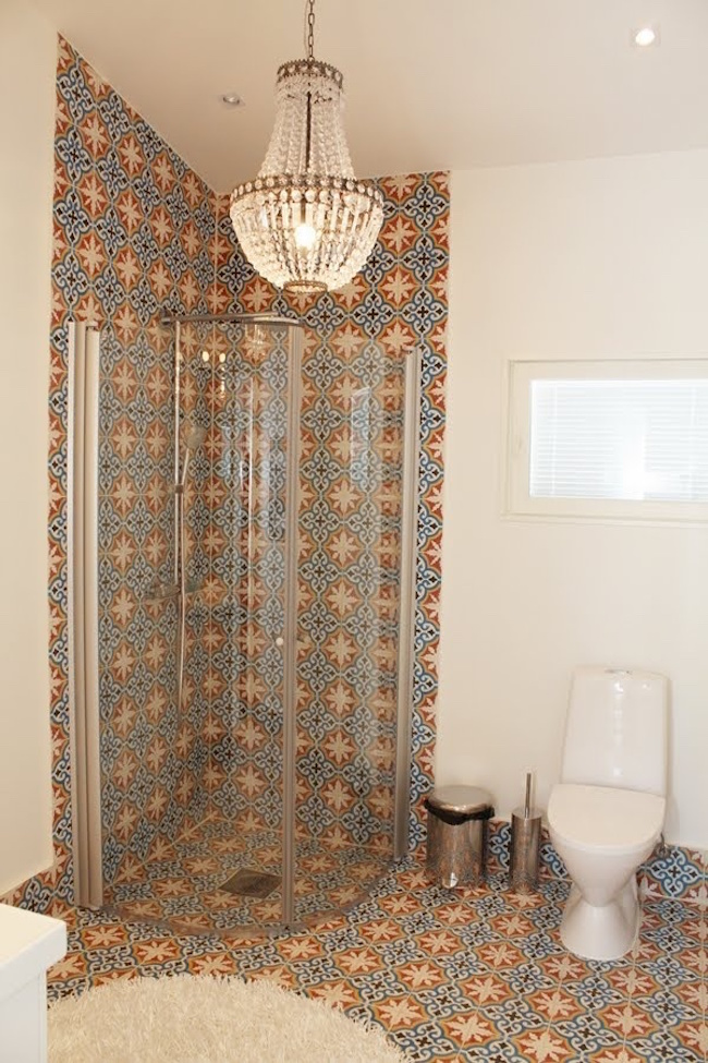 moroccan tile bathroom with chandelier