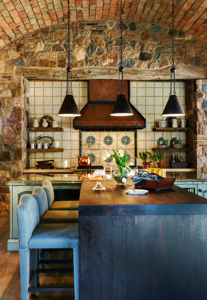 Kitchen Mediterranean with brick walls barrel vault ceiling