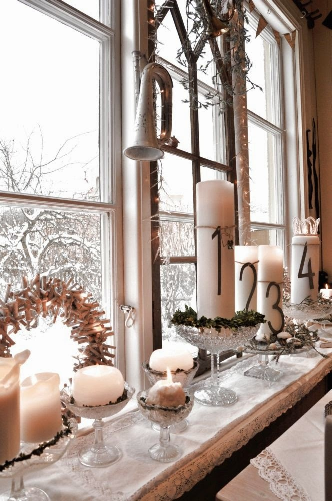 decorate the windows for christmas with candles