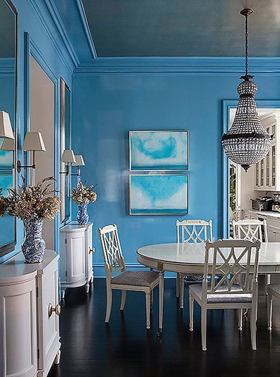 sky blue dining room with all white dining table