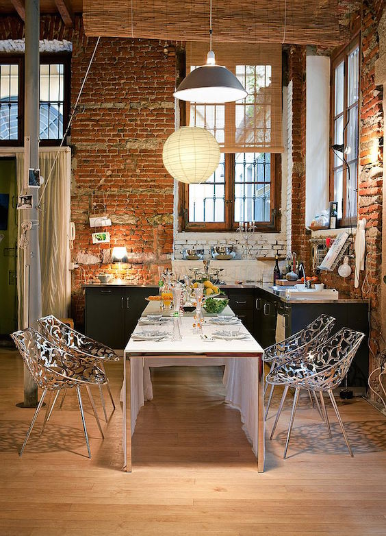 dining room with bricks wall
