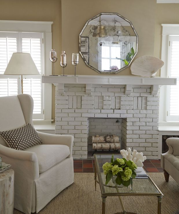 living room with white brick fireplace